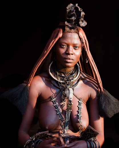 Their elaborately braided hair, skin and clothes covered in a mixture of ground red rock and butter, the women of Namibia's Himba tribe are a striking sight